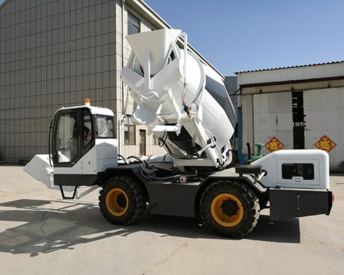 self loading concrete mixer machine